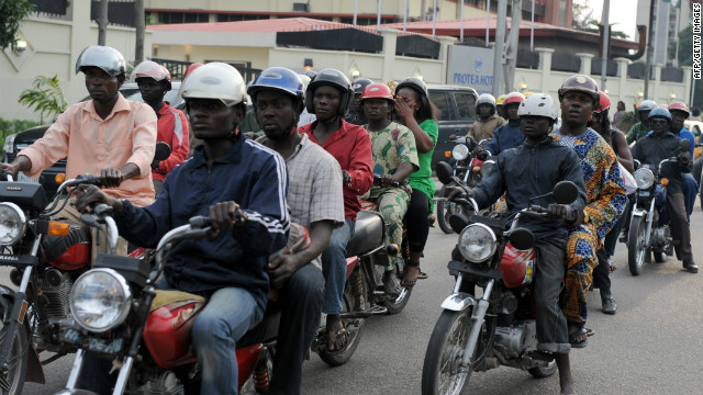 Riding a motorcycle taxi, also known as &quot;okada,&quot; is one of the ways to get around Lagos. 