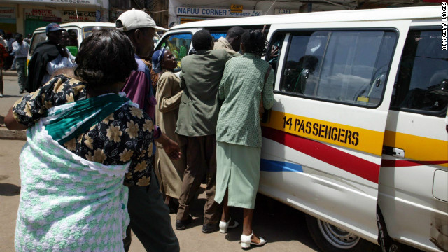 "In Nairobi, many people have to ride to work in crowded, privately owned minibus taxis called ""matatus."""