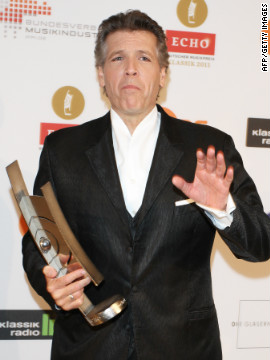 "Hampson has won a litany of awards, including multiple Grammys, two Edison Prizes and the coveted Grand Prix de Disque -- the highest award for musical recordings in France. Here he is pictured clasping the award for ""singer of the year"" at the 2011 ECHO Klassik awards in Berlin."