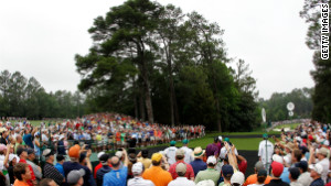 It was only a practice round, but a crowd gathered to watch Woods.