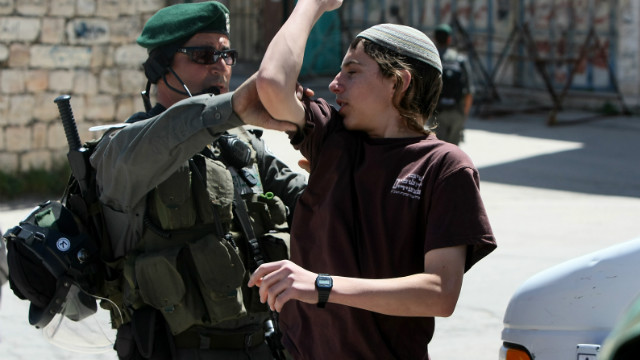 A Jewish settler argues with an officer as Israeli forces evict settlers from a house in Hebron, West Bank on April 4.