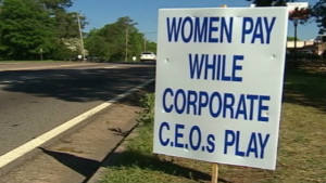 A sign protesting Augusta National Golf Club\'s no-women policy in 2002.