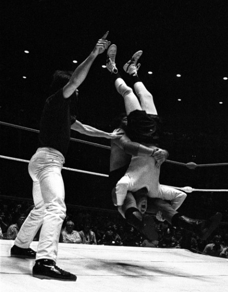 With Kaufman's head between his legs, Lawler delivers a vicious piledriver.
