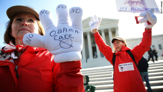 Tea Party members protesting President Obama's health care law outside the Supreme Court on March 27.