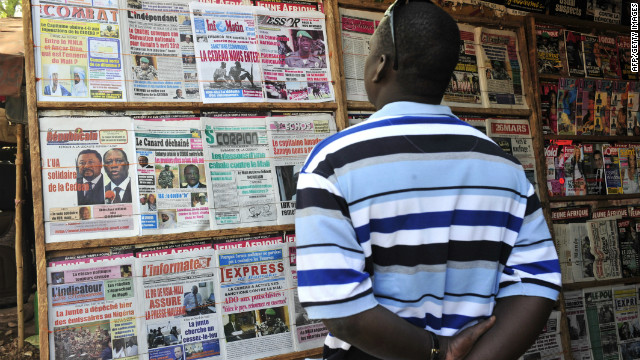 A man reads a local newspaper on Wednesday in Bamako, commenting on the situation in the north.