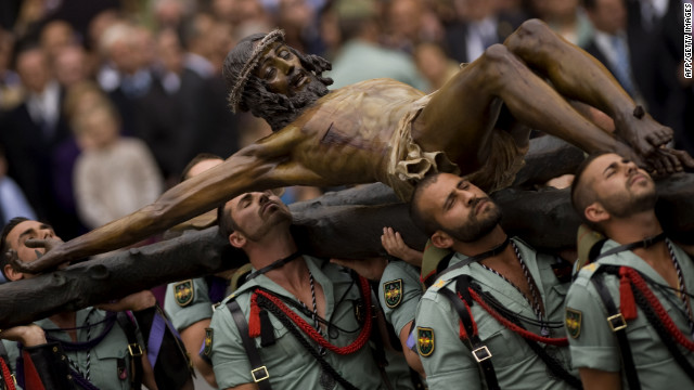 "Members of the Spanish Legion carry a statue of ""Christ of the Good Death"" to Santo Domingo de Guzman Church in Malaga, Spain, during a Holy Week procession."