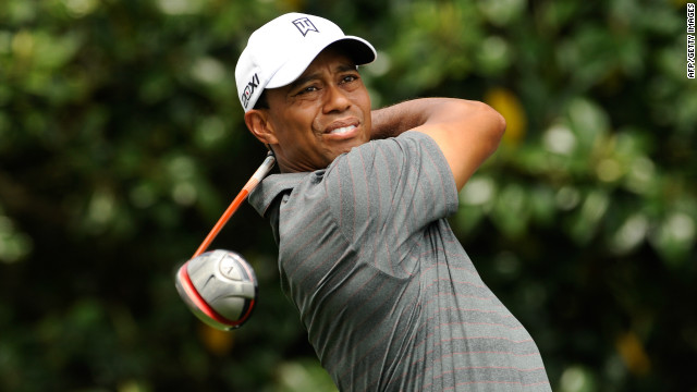 Tiger Woods tees off on the ninth hole at Augusta National during his opening round at the U.S. Masters. 
