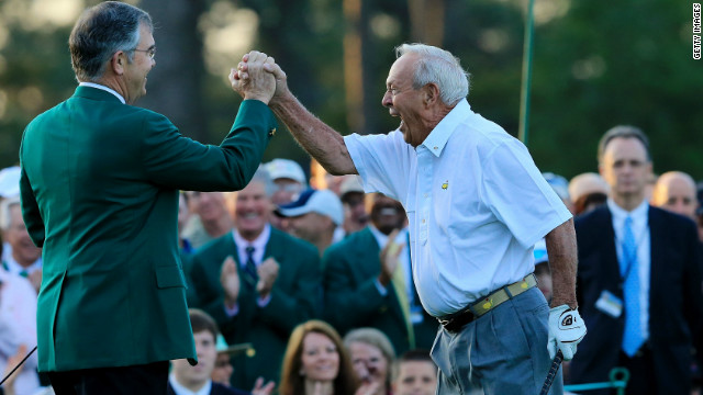 "Arnold Palmer, right, celebrates with Augusta National president Billy Payne after launching the 2012 Masters with a ceremonial tee shot 50 years after his ""Annus Mirabilis."" Palmer was joined by fellow golf legends Jack Nicklaus and Gary Player in making the honorary drives down the fairway."