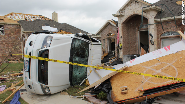 An estimated 13 tornadoes may have touched down in north Texas on Tuesday, the National Weather Service said. 