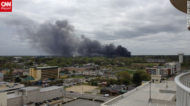 iReporter David Bryan saw smoke from his hotel balcony in Virginia Beach and shot this photo. &quot;You could smell the jet fuel, and all we could see was the black smoke,&quot; he said. 