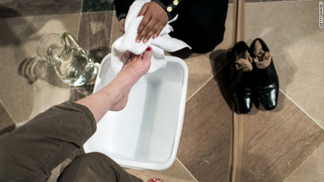 Parishioners wash each others' feet during the Maundy Thursday Mass celebrating the Last Supper of Jesus and his disciples at the National Cathedral in Washington on Thursday.