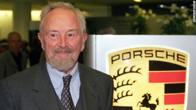 Picture from January 22, 1999 shows Ferdinand Alexander Porsche next to the logo of German car maker Porsche in Stuttgart.