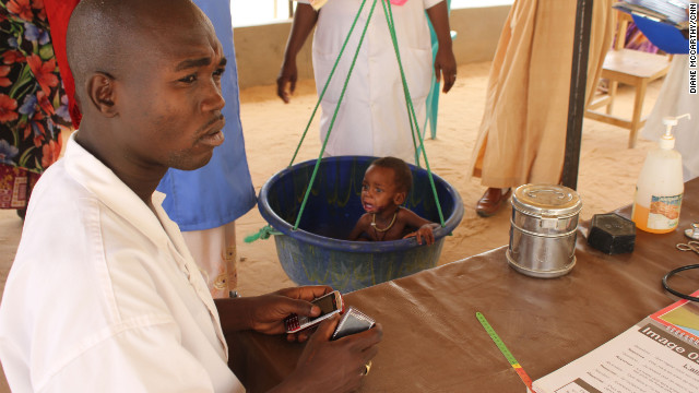 A child is weighed in at a nutritional feeding center in Mao, Chad. UNICEF estimates that more than a million children are at risk across the Sahel.
