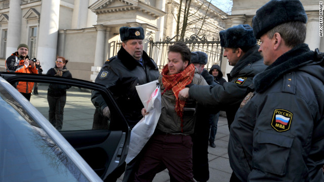 Police officers detain a gay rights activist who tried to protest against local anti-gay legislation in St. Petersburg on April 5, 2012.