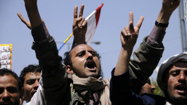 Yemeni protesters demand the restructuring the military and security units during a demonstration in Sanaa on March 29, 2012.
