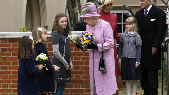 Queen Elizabeth II receives flowers from young people while her husband, Prince Philip, Duke of Edinburgh, daughter-in-law, Sophie, Countess of Wessex, and granddaughter Lady Louise Windsor look on as they leave Saint George's Chapel in Windsor Castle after attending the Easter service. 