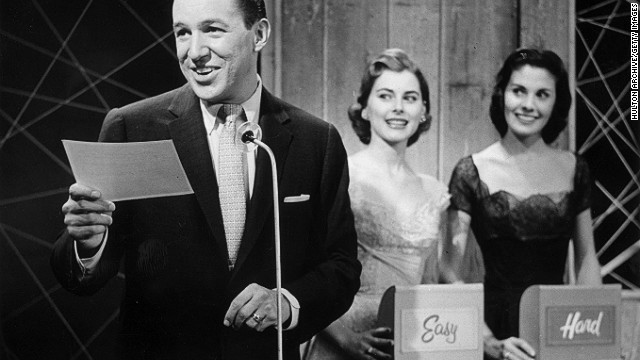 "Wallace, as host, reads a question in this production still from the 1956 quiz show, ""Big Surprise."""