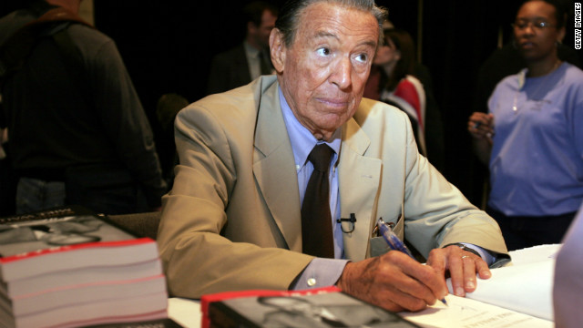 "Wallace signs his book ""Between You and Me"" at the 2005 Book Expo in New York City."
