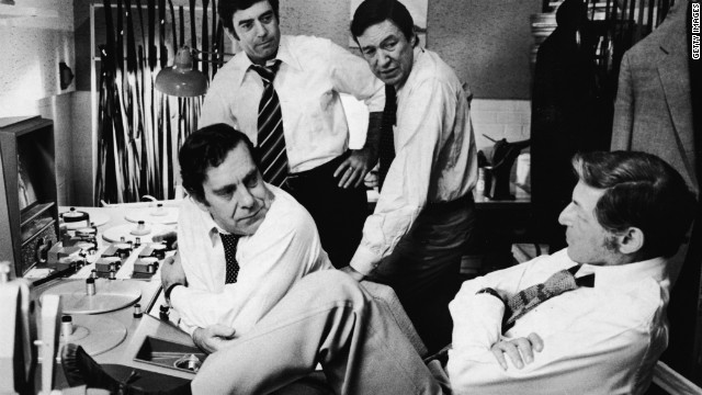 &quot;60 minutes&quot; correspondents Morley Safer, from left, Dan Rather and Mike Wallace, and executive producer Don Hewitt, right, discuss upcoming segments during the 1970s. 