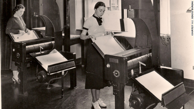 Census Bureau employees process microfilm records, circa 1940. Online records mean no more traveling to microfilm archives.