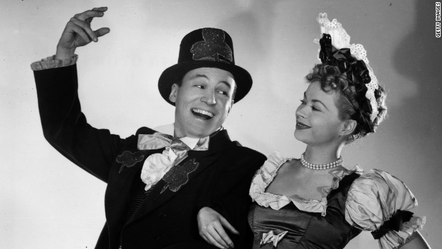 "Wallace and his then-wife, Buff Cobb, dressed in costume for a 1952 St. Patrick's Day episode of their CBS show, ""Mike and Buff."" The newsman was a communications officer in the U.S. Navy during World War II before landing a series of television jobs in Chicago and trying his hand at acting."