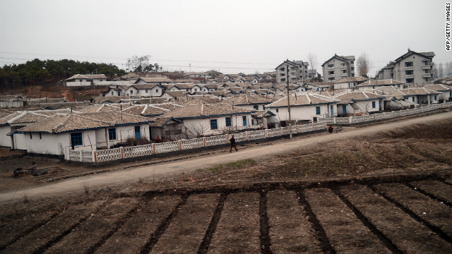 A North Korean soldier is seen from the window of a train as he walks near a small town along the railway heading from Pyongyang to the North Pyongan Province on the west coast.