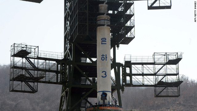 North Korean technicians check the Unha-3 rocket at Tangachai-ri space center on Sunday, April 8.