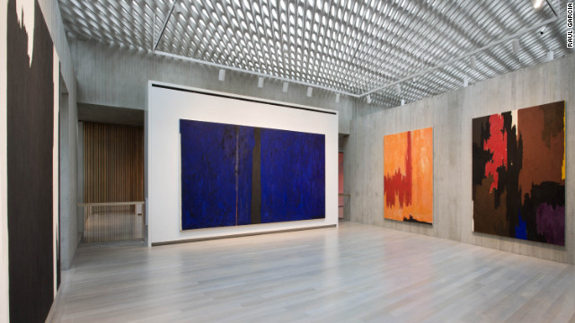 The Clyfford Still Museum's design allows natural light to enter the galleries through a series of skylights over a perforated concrete ceiling. 