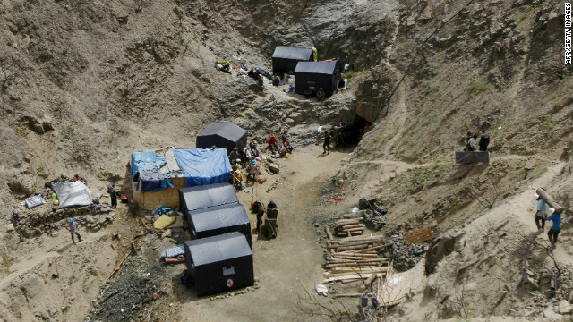 Relatives and rescuers of nine trapped miners remain at an encampment close to the mouth of Peru's Cabeza de Negro mine.