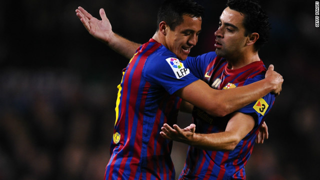 Alexis Sanchez of Barcelona celebrates with his teammate Xavi Hernandez after scoring the opener in the Nou Camp.