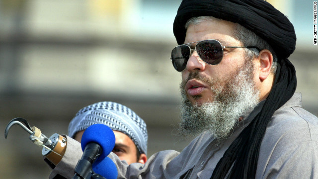 Radical muslim clerk Sheikh Abu Hamza gestures at the 'Rally for Islam' in central London in August 2002.