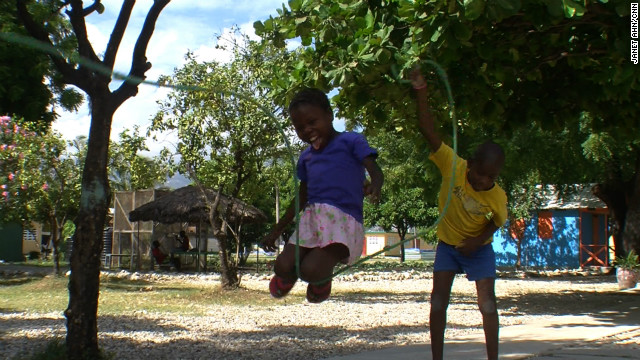 Lavita enjoys a game of jump rope at the New Life center. 