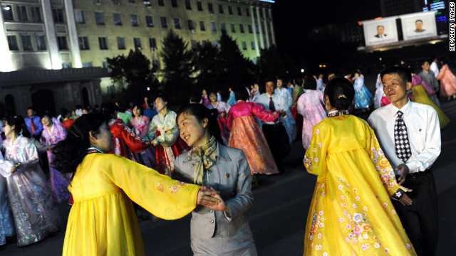 Citizens dance on Monday during a rehearsal for the commemoration of Kim Il-Sung's 100th birthday anniversary. Japan, the United States and South Korea see the launch -- which would violate U.N. Security Council resolutions -- as a cover for a long-range ballistic missile test. And a South Korean intelligence report says it's likely to precede a nuclear test, as it did in 2006 and 2009.