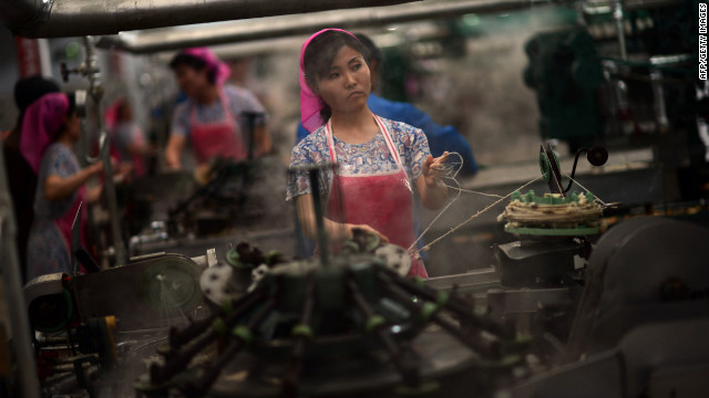 Employees work in a textile factory in Pyongyang. 