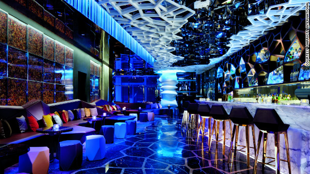 The glitzy bar at the Ritz-Carlton, Hong Kong, is a world away from the simple motels of the 1950s. Marriott's first foray into in Asia was with the JW Marriott Hotel Hong Kong, opened in 1989. &quot;I had a feeling we had to be in Asia, we had to be over there,&quot; said Marriott. &quot;There was growth coming.&quot;