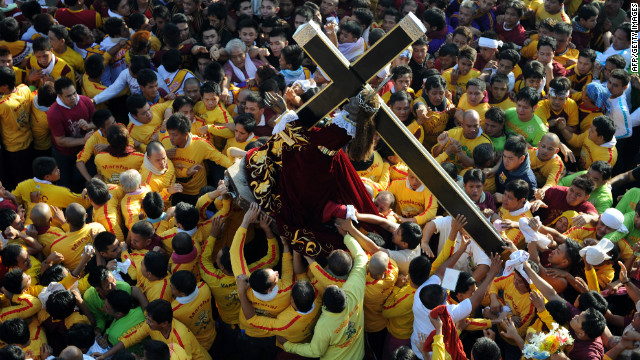 The Philippines is a predominantly Catholic country, a faith held by an estimated 83% of the population. The pictured Black Nazarene annual procession, one of the country's most spectacular religious events, attracted between two to three million people in the capital of Manila this year.