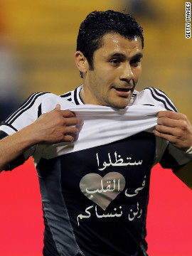 Ahmed Hassan displays a shirt with the message &quot;You will remain in our hearts and we will never forget you&quot; in reference to victims of the Port Said tragedy. His former club Al-Ahly had played in the match against Al-Masry where fans rioted.
