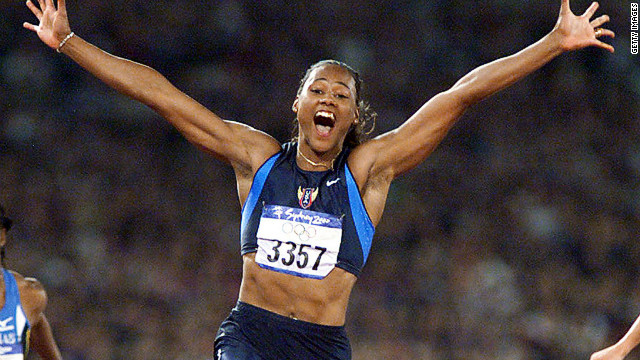 Marion Jones crosses the line first in the 100m final at the 2000 Olympics. It was one of three golds the American sprinter won in Sydney. In 2007, Jones admitted to taking banned substances and was stripped of her medals. 