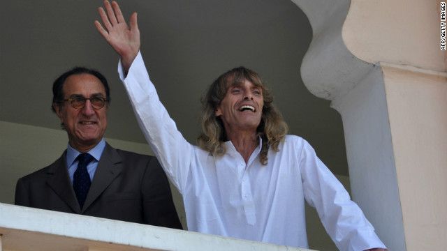 Italian citizen Paolo Bosusco (right) gestures to media representatives on Thursday after his arrival in Bhubaneswar.