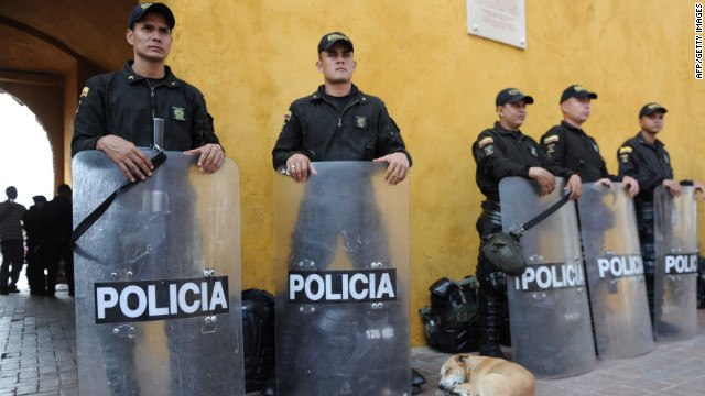 Riot police guard next to the Press Centre of the VI Summit of the Americas in Cartagena, Colombia on April 12.
