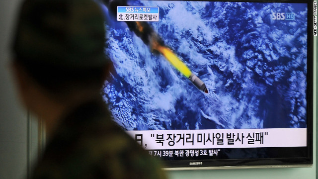 A TV screen in Seoul, South Korea, shows North Korea's rocket launch on Friday. 