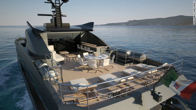 The open air top deck of the Columbus Sport 130' Hybrid contains space for dining and sun-lounging.