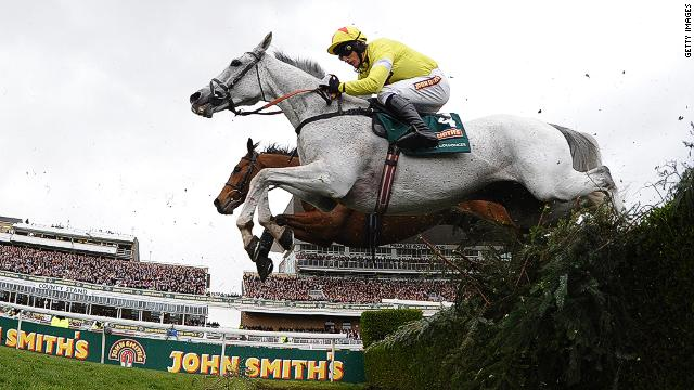Neptune Collonges ridden by Daryl Jacob jumps the water jump during the Grand National at Aintree Racecourse in Liverpool, UK.