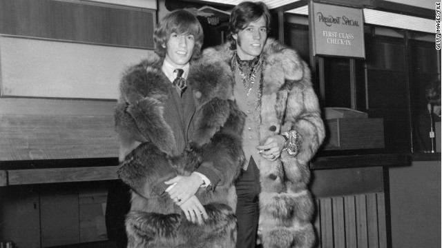 Robin Gibb, left, and brother Barry at London's Heathrow Airport in 1967.