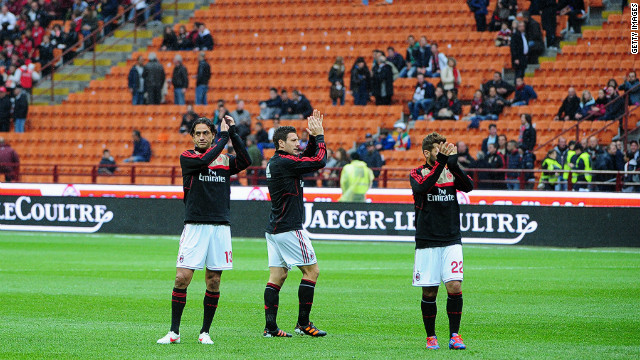 AC Milan's players acknowledge the crowd after the cancellation of the Serie A match against Genoa on Saturday.