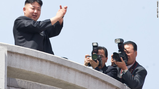 North Korean leader Kim Jong Un, left, watches a military parade in Pyongyang in honour of the 100th birthday of his grandfather, the late North Korean leader Kim Il Sung.<br/><br/> Kim Jong Un spoke before troops and citizens on Sunday as part of the massive, orchestrated celebration.
