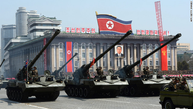 North Korean artillery units are displayed for the thousands of spectators.