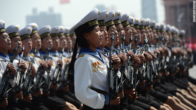 Female members of North Korea's military march during at the parade.