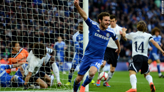 Chelsea versus Tottenham Hotspur again in the Premier League, this time in the semifinal of the 2012 FA Cup. Here, Juan Mata celebrates his goal despite the ball appearing to be blocked short of the line by a Tottenham defender.