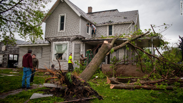 Residents clean up in the aftermath of the storm on Saturday, in Thurman. 